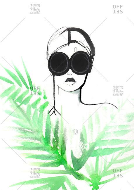 Spy peering through palm leaves