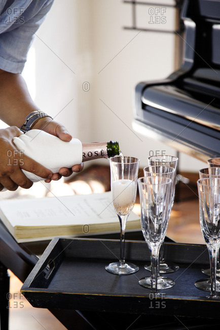 Man pouring champagne at party