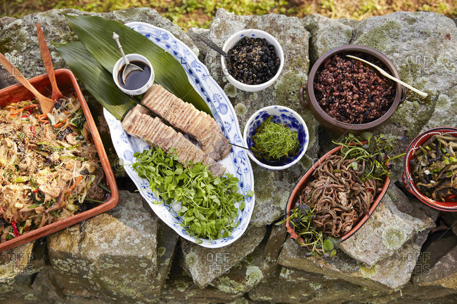 Korean dishes set out for outdoor meal