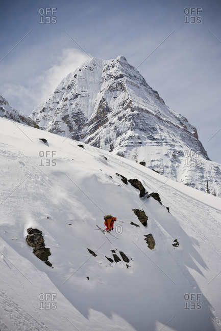 A backcountry skier skiing, Mount Assiniboine Provincial Park, British Columbia, Canada