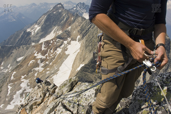 Climbers preparing to climb the classic north west ridge of Mt Sir Donald, Glacier National Park, British Columbia, Canada