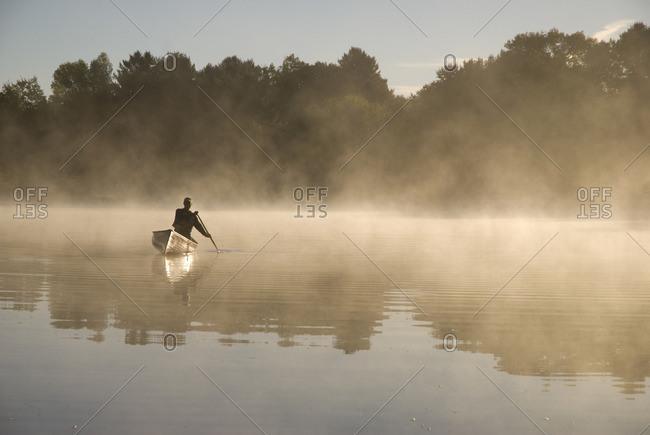 Solo Paddler on the Severn River in Muskoka, Ontario, Canada