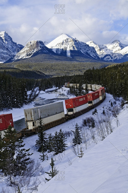 January 27, 2011: Train at Morant's curve with Haddo Peak, Saddle Mountain, Fairview Mountain in the background, Banff National Park, Alberta, Canada