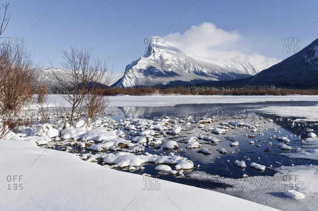 Mount Rundle from Vermilion Lakes.  Hot springs keep parts of Vermilion Lakes ice free even when it is -20 outside, Banff National Park, Alberta, Canada