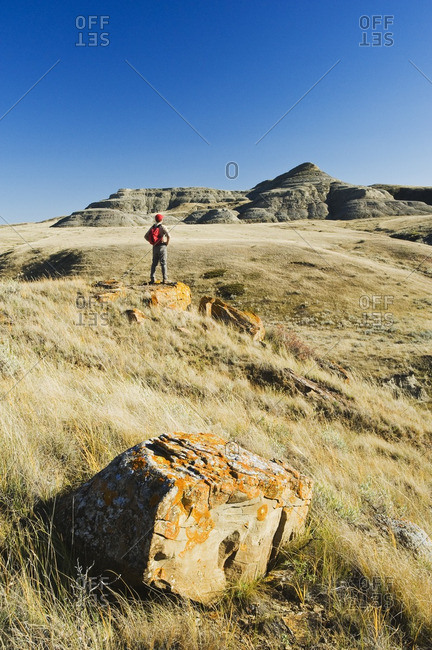 Hiker in the Killdeer Badlands, East Block, Grasslands National Park, Saskatchewan, Canada