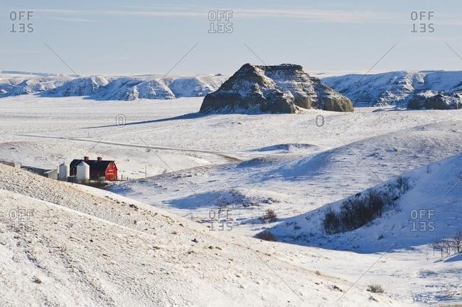 Big Muddy Badlands with Castle Butte and red barn,  Saskatchewan, Canada