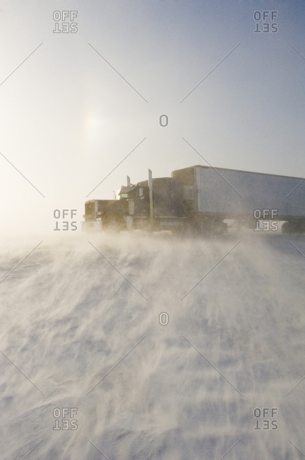 Road covered with blowing snow, near Morris, Manitoba, Canada
