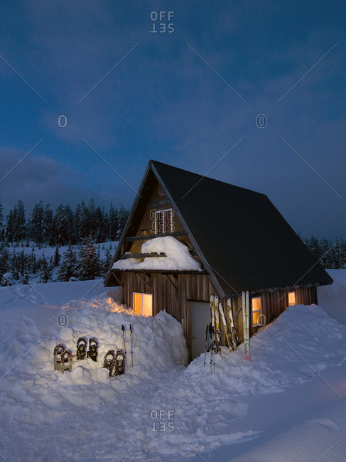 A quaint cabin makes for a beautiful scene at dusk while providing shelter for snowshoers and cross country skiiers in the 'Knuckleheads' near Powell River, British Columbia, Vancouver coast and mountain region, Canada