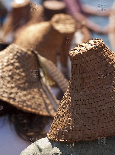 Woven cedar hats in the northwest Coast tradition at Songhees Reserve lands, Esquimalt, Victoria, British Columbia, Canada