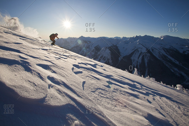 A backcountry skier skis through windslab in the Kicking Horse Backcountry, Golden, British Columbia, Canada