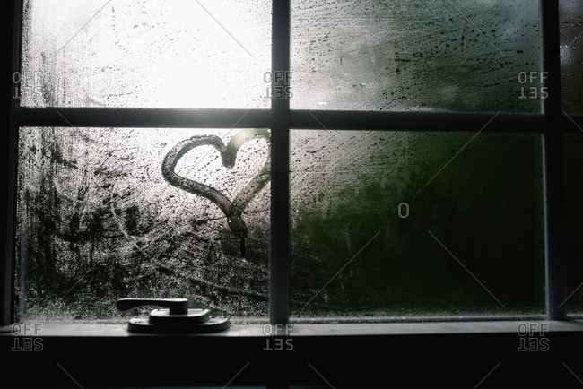 Close up of a heart drawn in conversation on a window