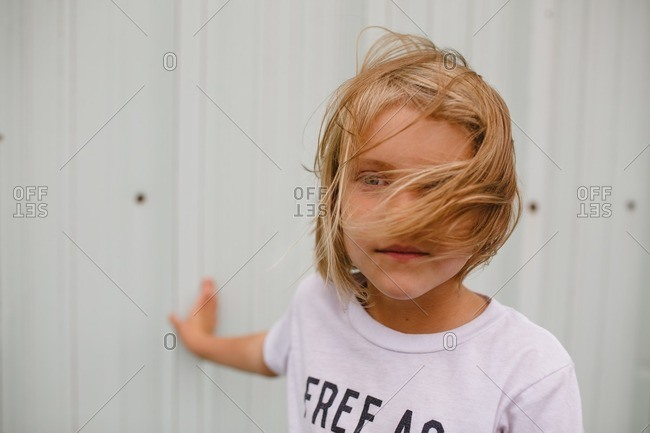 Close up of a little girl with windblown hair