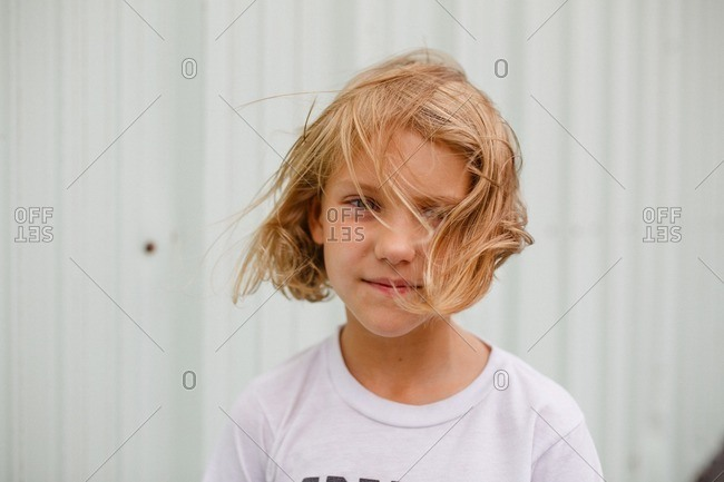 Portrait of a little girl with windblown hair
