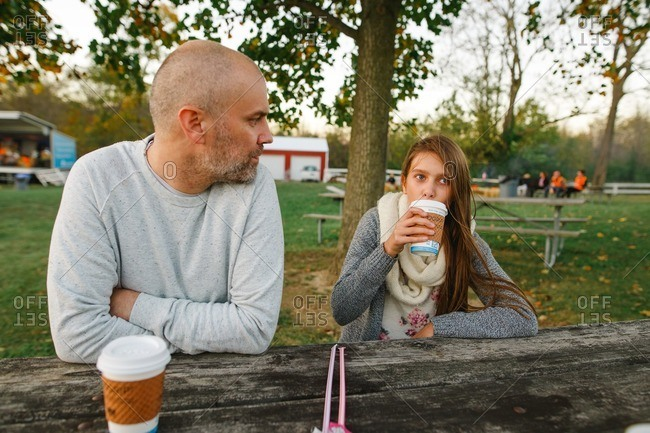 Dad and daughter with apple cider