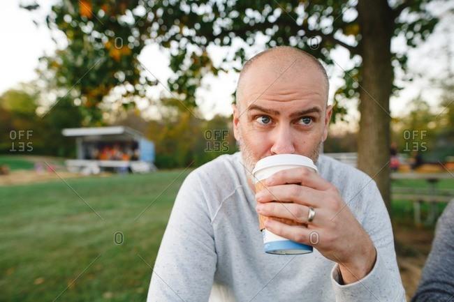 Man drinking hot drink
