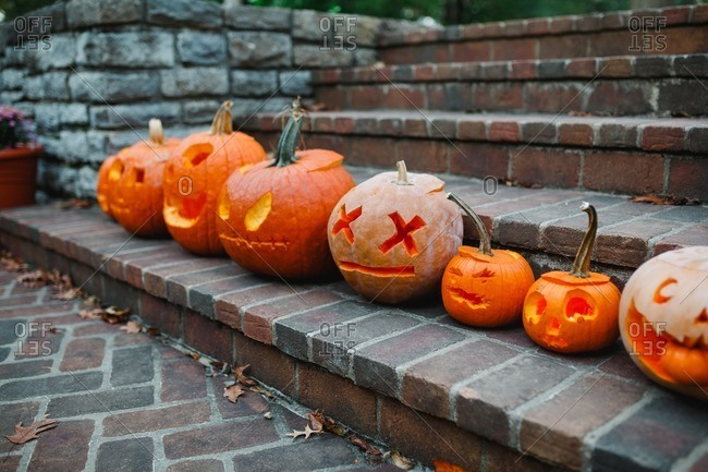 Close up of jack-o-lanterns in a row