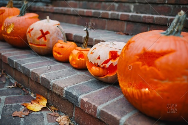 Close up of jack-o-lanterns in a row on steps