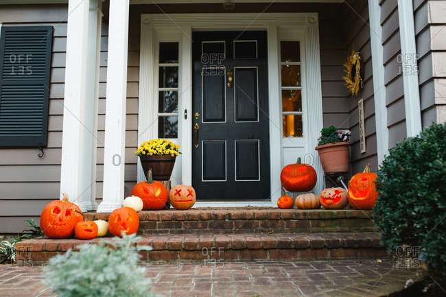 Front porch with jack-o-lanterns