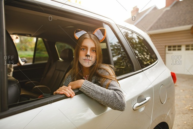 Tween girl looking out car window wearing fox makeup and costume stock photo - OFFSET  sc 1 st  Offset by Shutterstock & Tween girl looking out car window wearing fox makeup and costume ...