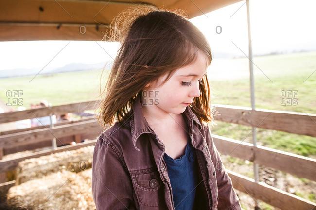 Little girl standing on a hayride wagon