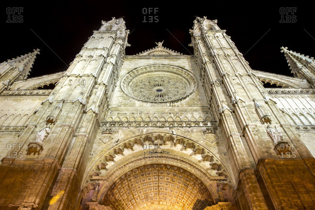 Facade of an elaborately carved church at night
