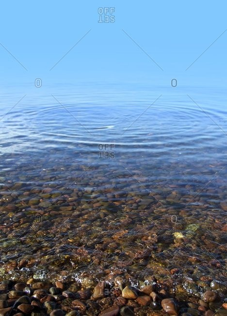 Calm water at the shore of a lake