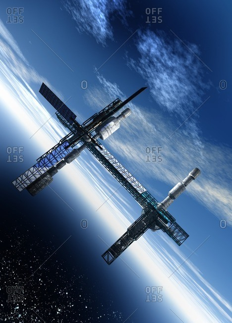 Space station Computer artwork of a space station orbiting the Earth