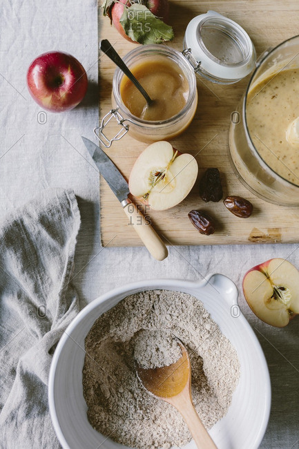 The ingredients for apple muffins are photographed from the top view