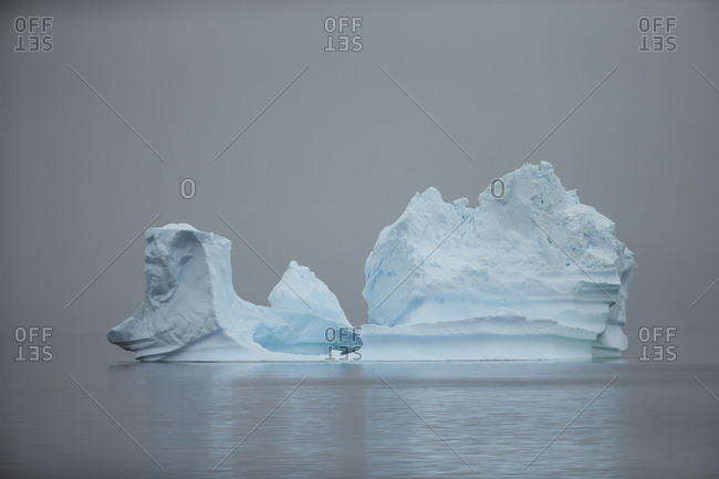 Iceberg floating on calm water in Andvord Bay.