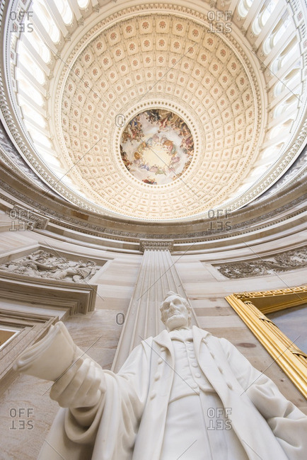 Washington, District of Columbia, USA - October 10, 2012: Abraham Lincoln statue inside the United States Capitol Building dome.