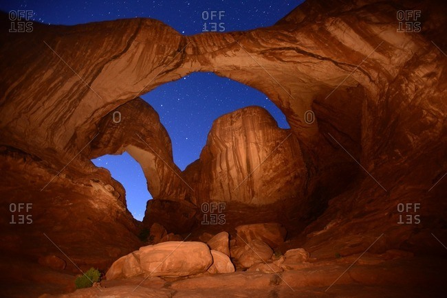 Double Arch at night in Arches National Park.