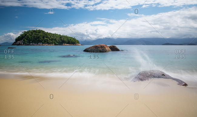 A tropical paradise beach on Ilha das Couves off the coast in Ubatuba, Brazil.