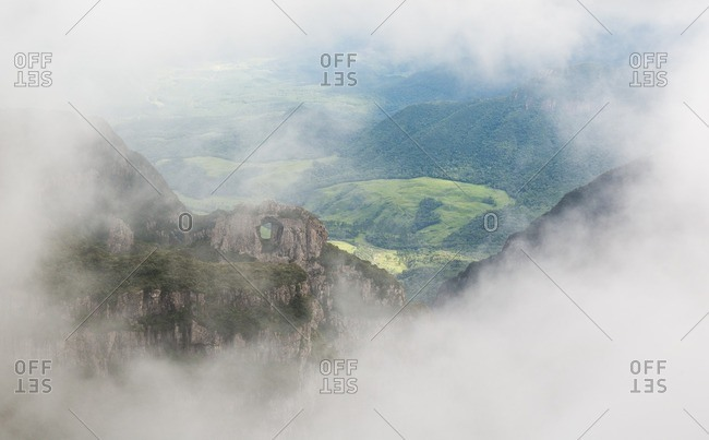 Morro da Igreja rock in the cloud and mist near Urubici, Santa Catarina, Brazil.