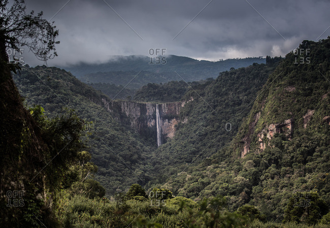 Cachoeira do Avancal waterfall with ominous cloud in Urubici, Brazil.