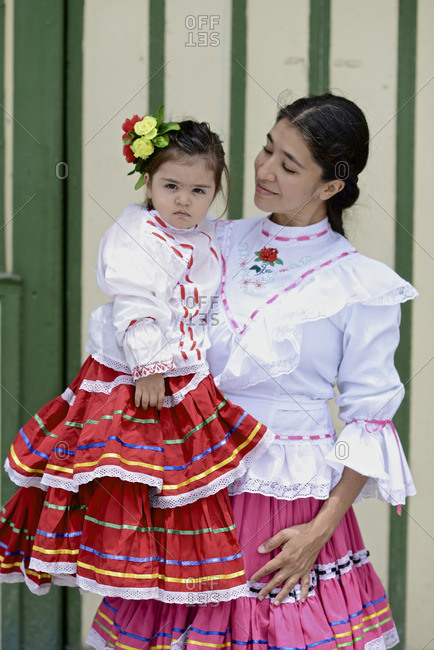 Colombia - August 27, 2016: A mother and daughter wearing traditional Colombian attire.