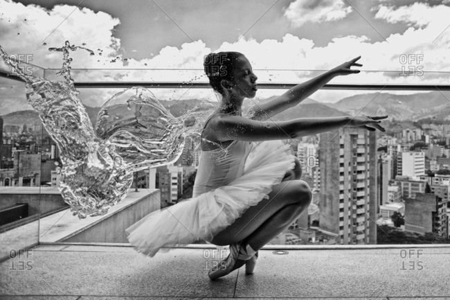 Ballerina balancing on a rooftop in Medellin.