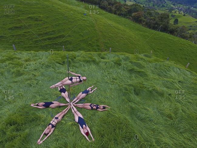 High angle view of pole dancers.