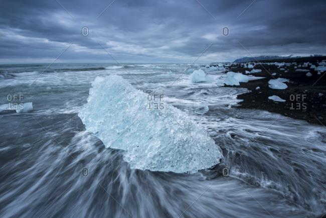 Iceberg from Jokulsarlon lagoon on a black sand beach.