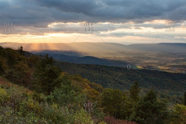 Sun rays breaking through storm clouds over Shenandoah National Park.