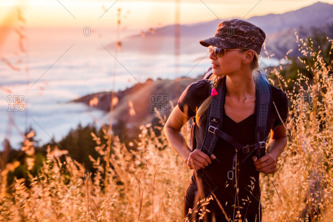 Portrait of a young woman hiking in Big Sur, California, USA.