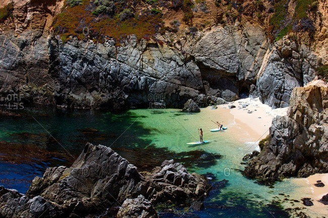 California, USA - September 26, 2012: Paddleboarders head out into a secluded bay.