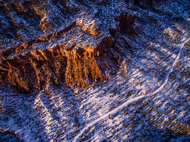 An aerial view of a sandstone canyon in winter.