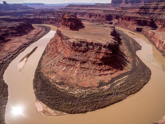 The Colorado River meanders around rock formations at Horseshoe Bend.