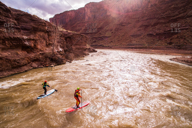 Two paddleboarders on the Colorado River.
