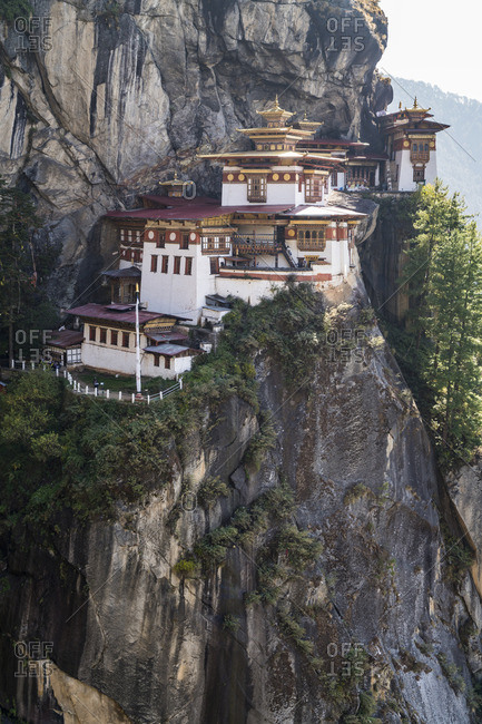 Paro Taktsang temple enveloped in fog in upper Paro valley, Bhutan.