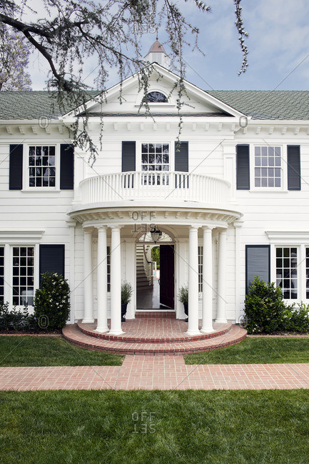 May 18, 2015: Upscale home with rounded portico at entrance