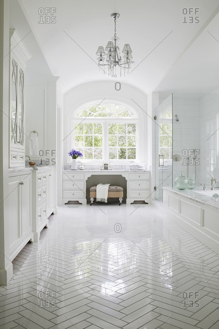 Pristine and stylish white bathroom in upscale home