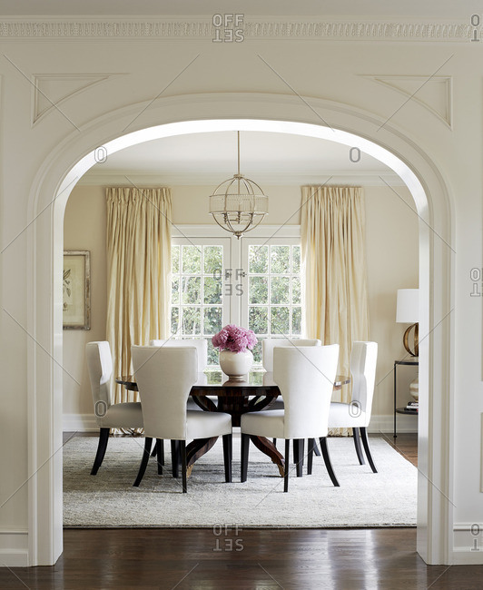 Round dining tale with white chairs in upscale home
