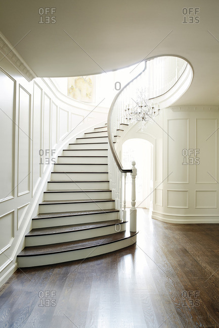 Elegant, curved staircase in an upscale home
