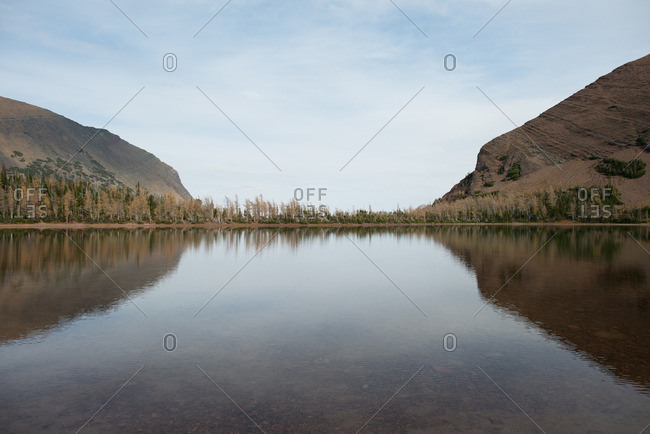 Scenic view of a lake between two mountain ridges